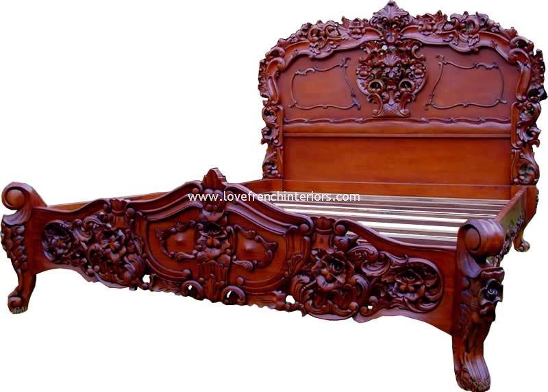 Rococo ornately carved bed in mahogany